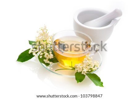 Elder tea with elder flowers - stock photo