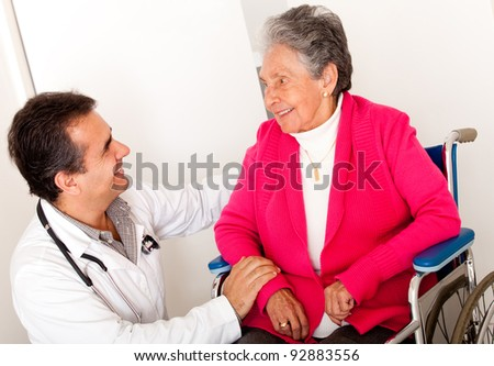 Elder woman sitting in a wheelchair at the hospital talking to the doctor