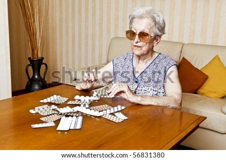 elder woman with pills