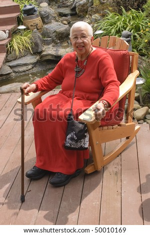 Elderly African American Woman sitting in garden - stock photo