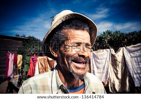 elderly african man in a old...
