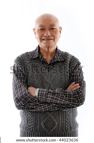 elderly asian man standing against white background