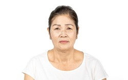 elderly asian woman portrait 60-70 years old no make up with white clothes black hair and hazel eyes isolated on white background