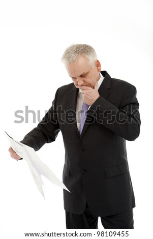 elderly businessman looking pensively at a planned and deliberate - Isolated Image