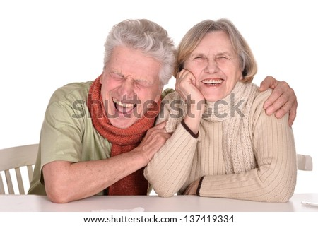 Elderly caucasian couple ill with influenza over a white background