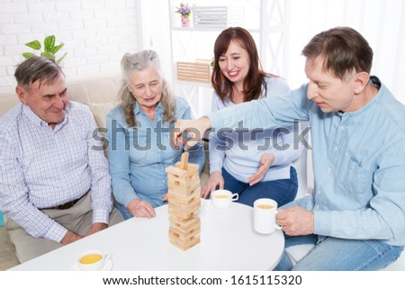 Elderly couple and elderly couple collect wooden blocks at home