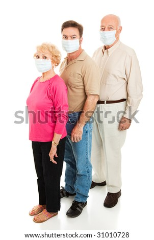 Elderly couple and their adult son wearing surgical masks to protect against a health epidemic.  Could be swine flu.