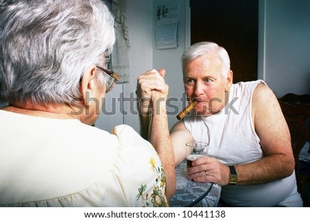 elderly couple Arm wrestling
