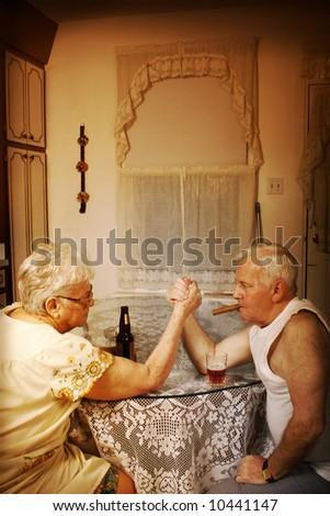 elderly couple Arm wrestling