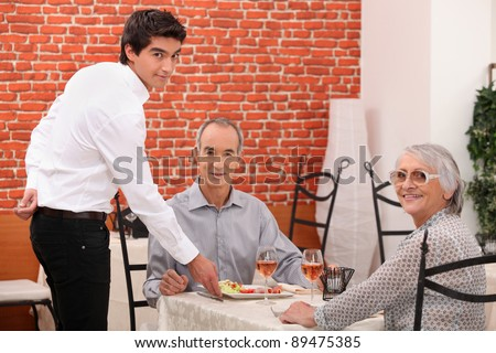 Elderly couple dining