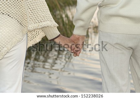 Elderly couple holding hands near river #152238026
