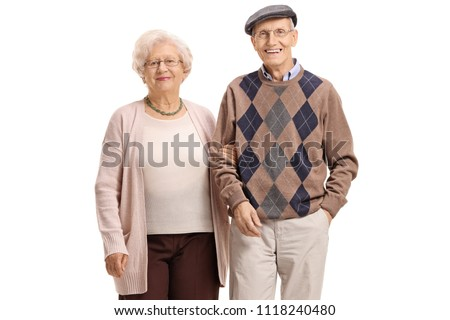 Elderly couple looking at the camera and smiling isolated on white background