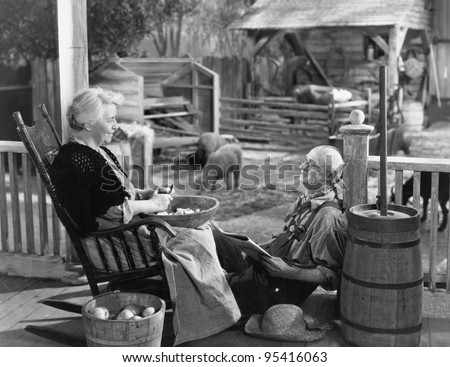 elderly couple on porch of...