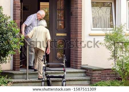Elderly Couple on Stairs at the Font Door