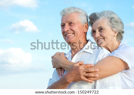 Elderly couple relaxing on a sunny day together