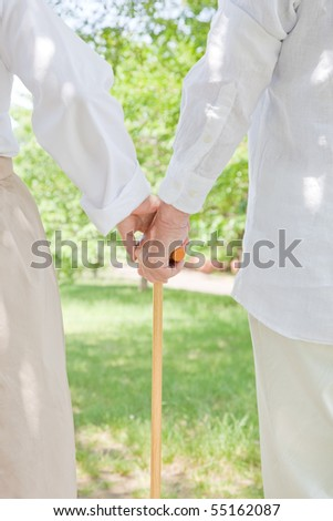Elderly couple who grips walking stick