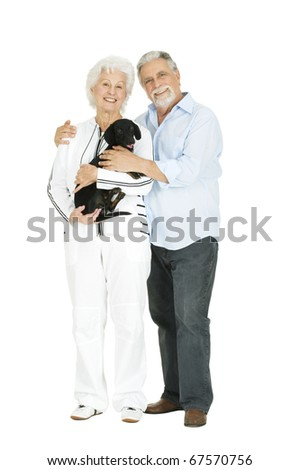 elderly couple with a dachshund