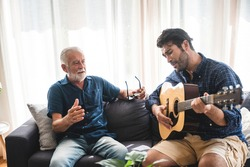 elderly dad and son are playing music at home, relax activity at home with family
