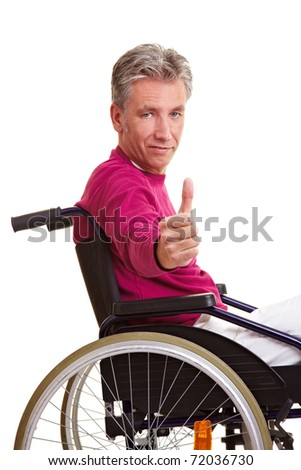 Elderly disabled man in wheelchair holding thumbs up
