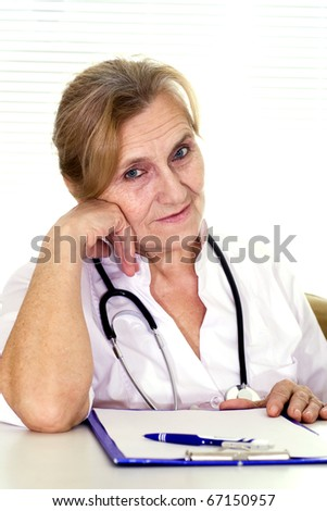 Elderly doctor sitting at the desk