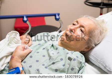 Elderly eighty-plus-year-old woman in a hospital bed.