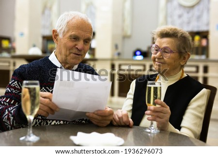 Elderly family drinking champagne and relaxing at lobby of theater at intermission Stock photo ©