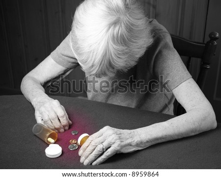 elderly frail woman not having enough money for her medication - stock photo