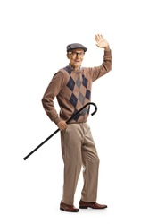 Elderly gentleman holding a cane and greeting with hand isolated on white background