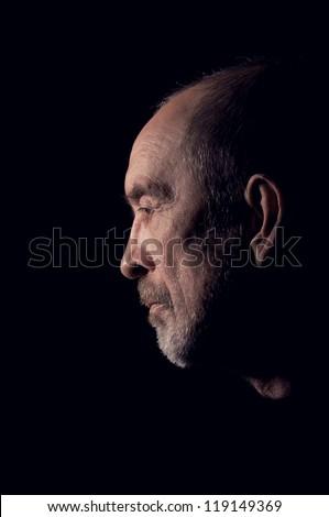 elderly gray man senior with beard in depression