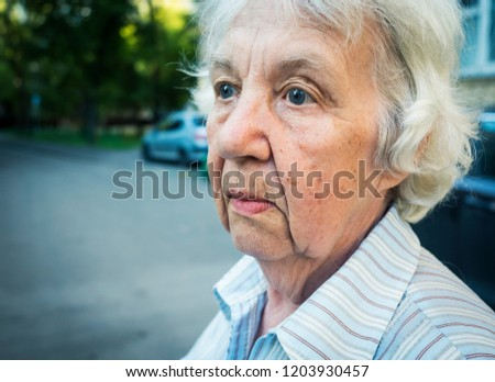 Elderly gray pensive woman on a walk #1203930457