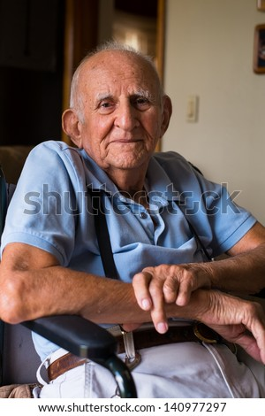 Elderly handicapped 80 plus year old man in a home setting.