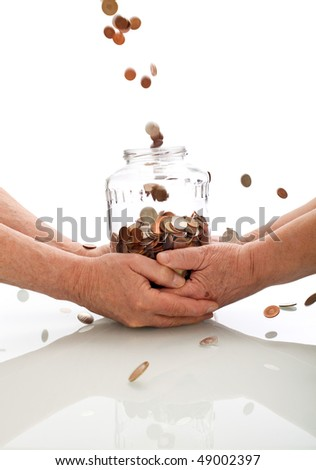 Elderly hands holding jar catching falling coins - successful investment of the retirement fund concept