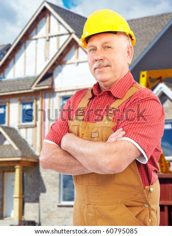 Elderly handsome builder new a new house