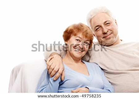 Elderly happy couple on a white background