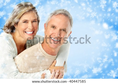 Elderly happy couple. Over snow blue background - stock photo