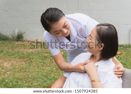 Elderly hold hand with caregiver of nurse of Nursing home. Elder smile and happy concept