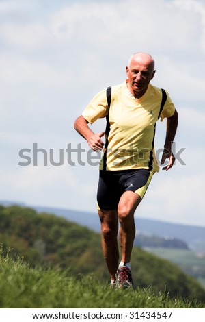 Elderly joggers trained for his fitness with jogging