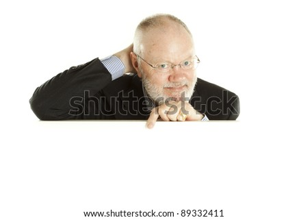 Elderly man above white display on wite background