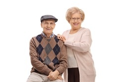 Elderly man and an elderly woman looking at the camera and smiling isolated on white background