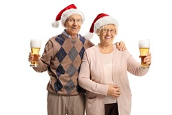 Elderly man and woman with santa claus hats toasting with glasses of beer isolated on white background