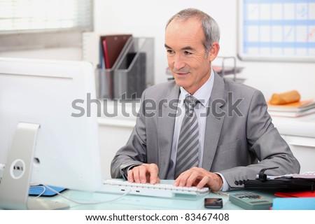 Elderly man at work