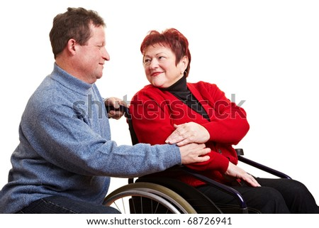 Elderly man caring for his senior woman in wheelchair