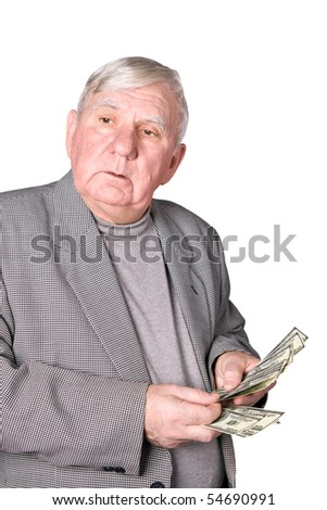 Elderly man considers money. Isolated on a white background
