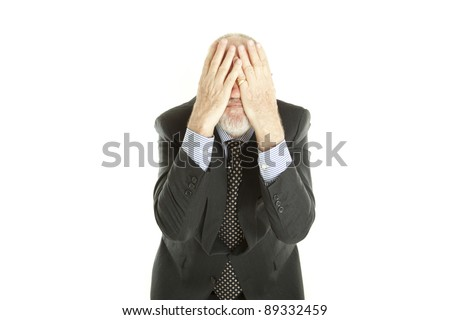 Elderly man hiding his face on white background