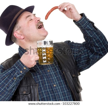 Elderly man holding a beer belly and sausage on white background