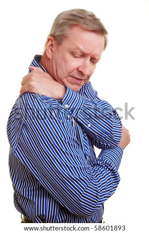 Elderly man holding hands to his aching back