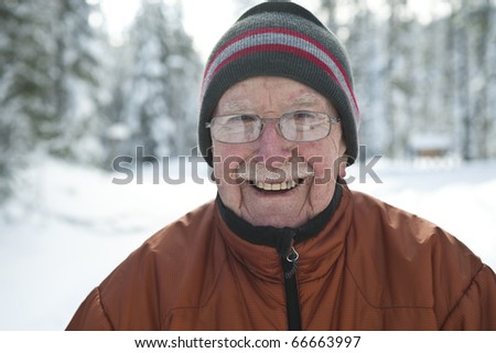 Elderly man in snowy winter scene