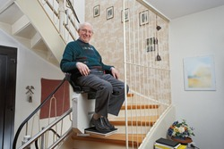 Elderly Man in the Staircase Using the Stairlift