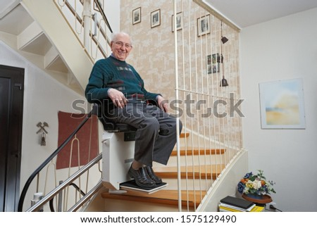 Elderly Man in the Staircase Using the Stairlift Stockfoto ©