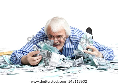 elderly man lying in the money on a white background